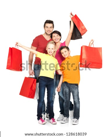 Happy family with shopping bags standing at studio over white background - stock photo