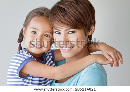 happy family with smiling, positive daughter and mother - stock photo
