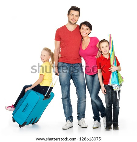 Happy family with  suitcase  at studio isolated on white background - stock photo