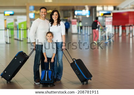 happy family with suitcases at airport - stock photo