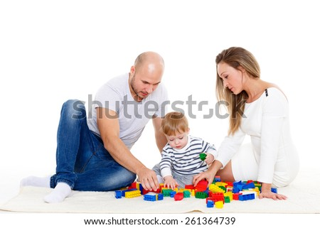 Happy family with sweet baby play on a white background. Early development and learning toys. - stock photo