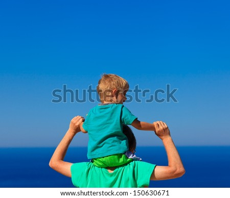 happy family with the sky on background - stock photo