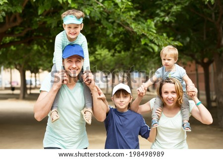 Happy family with three kids having city tour in summer day  - stock photo