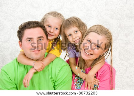 Happy family with two children - stock photo