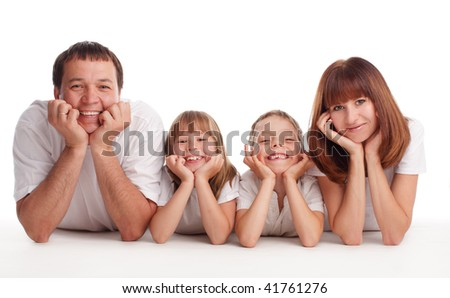 Happy family with two children isolated on white - stock photo