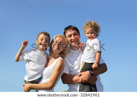 Happy family with two children. Many happy families search in my portfolio - stock photo