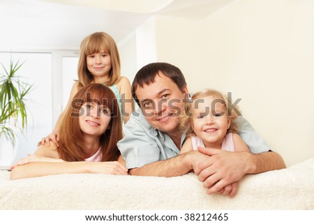 Happy family with two children on sofa