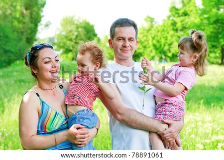 Happy family with two daughters having fun