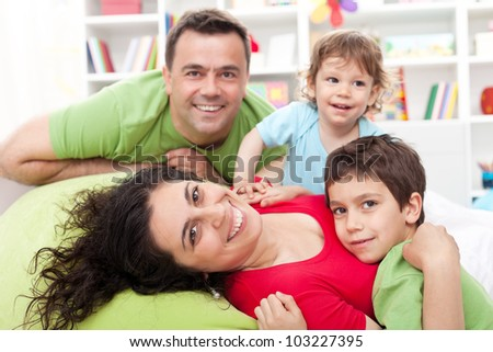 Happy family with two kids - together at home - stock photo