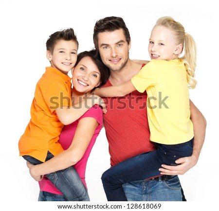 Happy family with two schoolchild children isolated on white background - stock photo