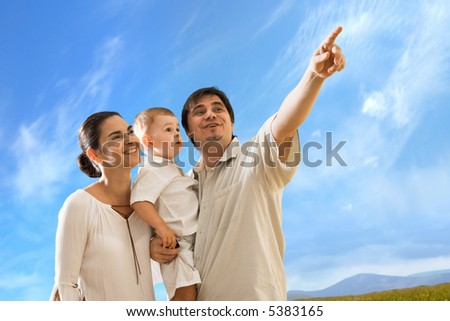 Happy family with 2 years old baby boy outdoor. - stock photo