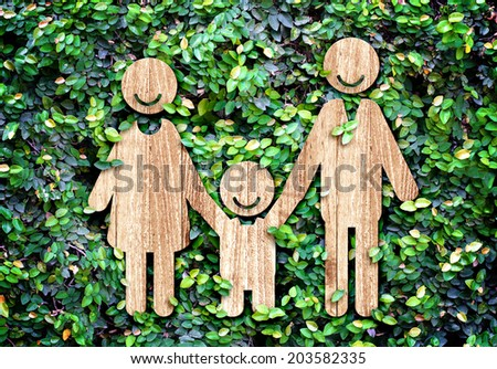 Happy family wood icon on green leaf wall,Eco concept - stock photo