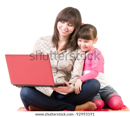 Happy family, young beautiful mother and her little daughter with laptop isolated over white - stock photo