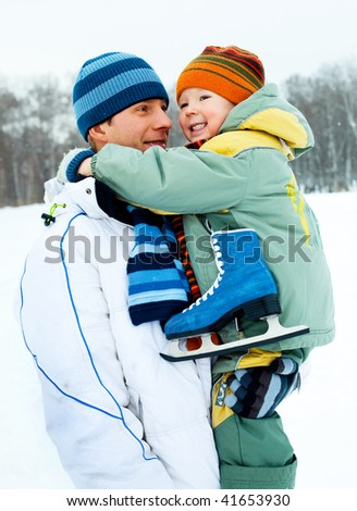 happy family, young father going ice skating with his little son - stock photo