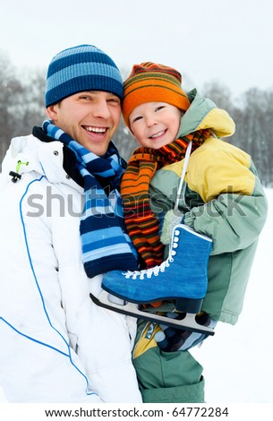 happy family, young father going ice skating with his little son