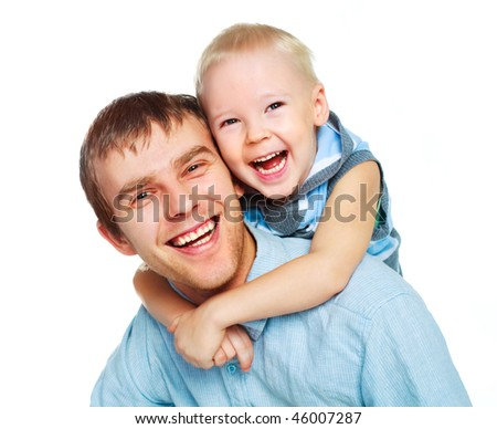 happy family, young father with his little son embrace and laugh - stock photo