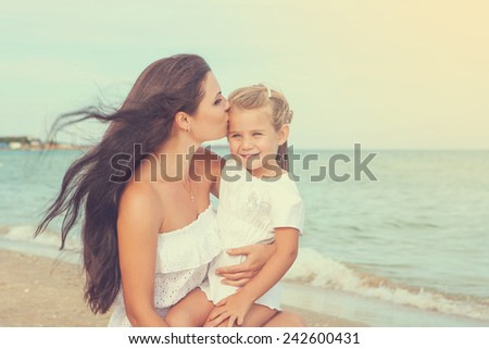 Happy family. Young happy beautiful  mother and her little daughter hugging. Positive human emotions, feelings, emotions. - stock photo