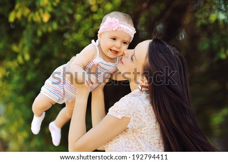 Happy family. Young mother and baby - stock photo