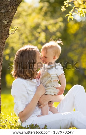happy family; young mother and her  son spending time outdoor on a summer day - stock photo