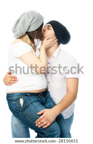 happy family, young pregnant woman and her husband kissing - stock photo