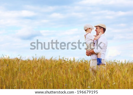 happy farmer family on wheat field - stock photo