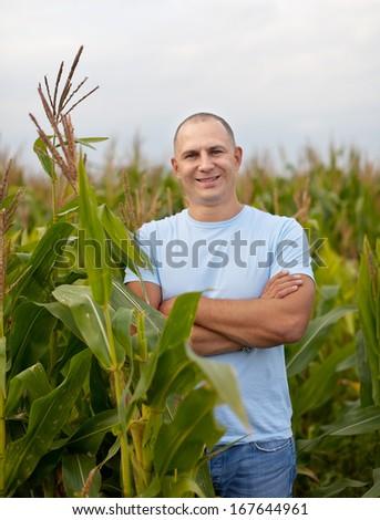 Happy  farmer in field of corn - stock photo