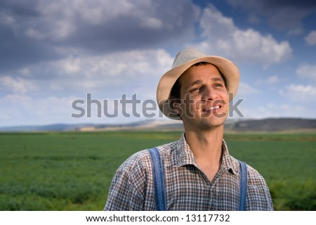happy farmer in the fields - stock photo