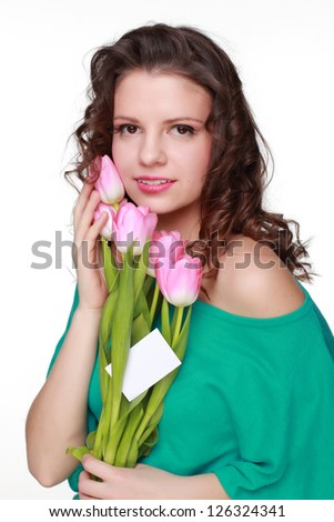 Happy fashion beautiful young woman with pretty pink tulips on Holiday theme
