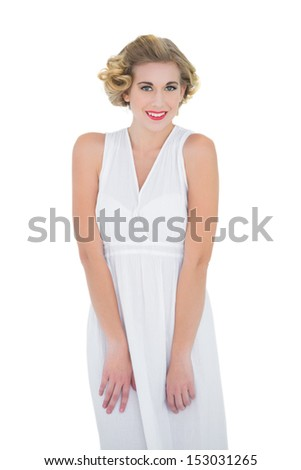 Happy fashion blonde model looking at camera on white background - stock photo