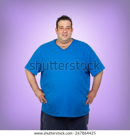 Happy fat man with blue shirt and a purple background - stock photo