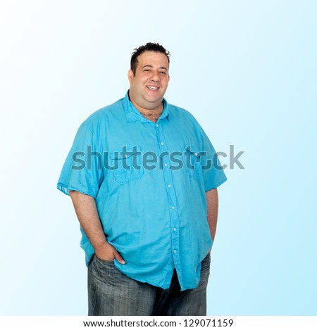 Happy fat man with blue shirt isolated on blue background - stock photo