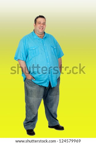 Happy fat man with blue shirt isolated with a green background - stock photo