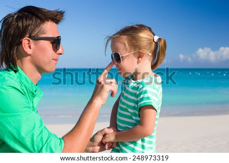 Happy father and adorable little girl during tropical beach vacation - stock photo