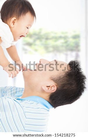 happy father and baby playing - stock photo