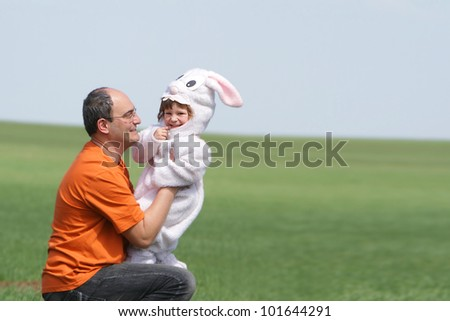 happy father and child on natural background (no-name costume) - stock photo