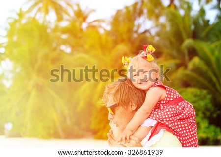 Happy father and cute little daughter at tropical beach - stock photo