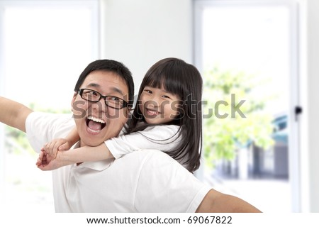 Happy father and daughter.Asian family lifestyle - stock photo