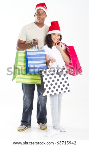 happy father and daughter carring christmas shopping bags - stock photo