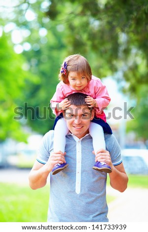 happy father and daughter having fun in park - stock photo