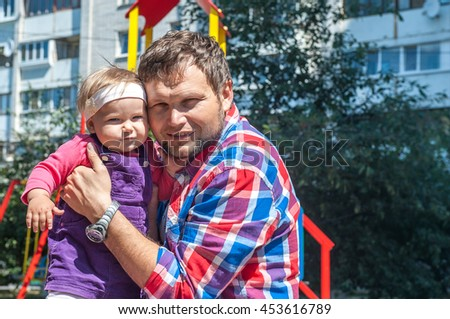 Happy father and daughter having fun together on the playground, family time concept - stock photo