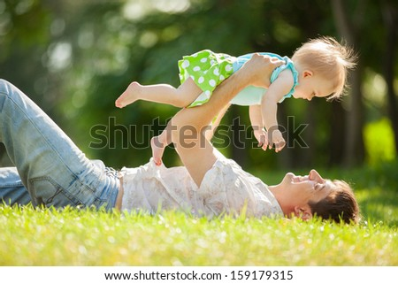 Happy father and daughter in the park - stock photo