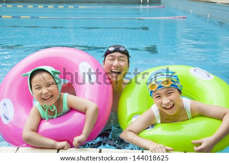 happy father and daughter in the swimming pool - stock photo