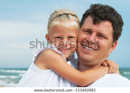 Happy father and daughter on the beach