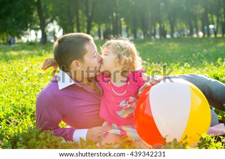 Happy father and daughter on the nature, kiss - stock photo