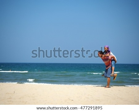 happy father and daughter playing on the beach at the day time - soft focus