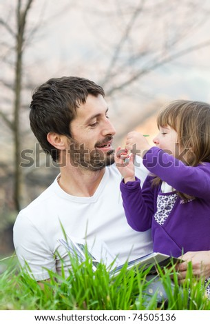 happy father and daughter playing outside - stock photo