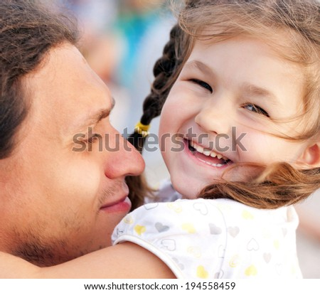 Happy father and daughter portrait, family playing together and having fun outdoor - stock photo