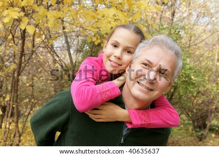 Happy father and daughter talking in autumn park - stock photo
