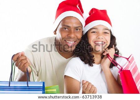 happy father and daughter with Christmas shopping bags - stock photo