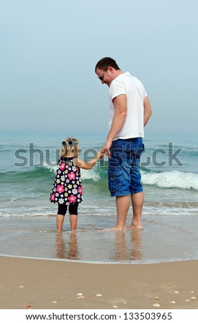 Happy father and his adorable little daughter